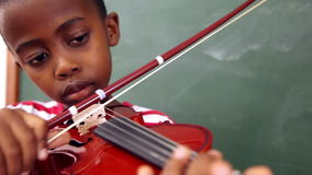 Cute pupil playing violin. In classroom at the elementary school stock video footage