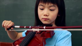 Cute pupil playing violin. In classroom at the elementary school stock video