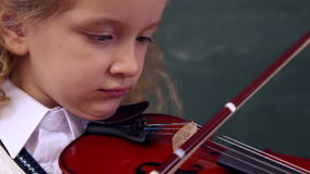 Cute pupil playing the violin. At elementary school stock footage
