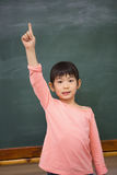 Cute pupil raising her hand Royalty Free Stock Image