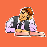 Red-haired schoolboy in a tie sits with a pensive look and looks in a notebook. A cute pupil in a shirt and waistcoat sits and looks in a school notebook, a Royalty Free Stock Image