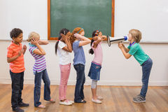 Cute pupil shouting in classroom Royalty Free Stock Image