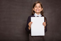 Cute pupil showing white page Royalty Free Stock Photography