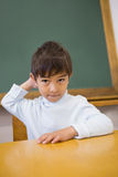 Cute pupil sitting at desk in classroom Royalty Free Stock Photos