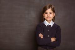 Cute pupil smiling at camera Royalty Free Stock Photography