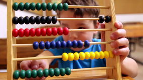 Cute pupil using abacus. In classroom at the elementary school stock video