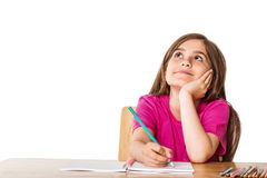 Cute pupil working at her desk Stock Images