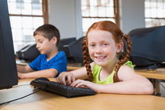 Cute pupils in computer class Stock Images