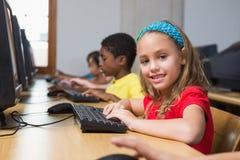 Cute pupils in computer class Stock Photos