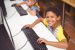 Cute pupils in computer class Royalty Free Stock Photo