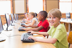 Cute pupils in computer class Royalty Free Stock Photos