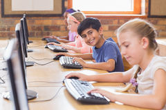 Cute pupils in computer class Royalty Free Stock Image