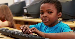 Cute pupils in computer class. At the elementary school stock footage