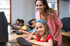 Cute pupils in computer class with teacher Stock Images