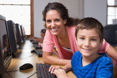 Cute pupils in computer class with teacher Royalty Free Stock Images
