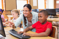 Cute pupils in computer class with teacher Royalty Free Stock Photography