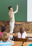 Cute pupils listening to their teacher in classroom Royalty Free Stock Photo