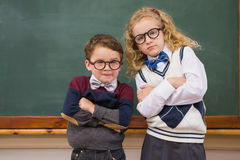 Cute pupils looking at camera with arms crossed Royalty Free Stock Photo