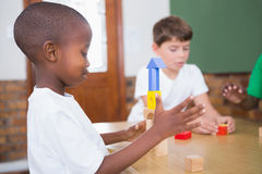 Cute pupils playing with building blocks Royalty Free Stock Photography