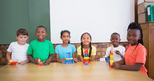 Cute pupils playing with building blocks Royalty Free Stock Photo