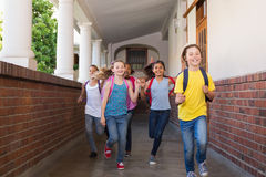 Cute pupils running down the hall Royalty Free Stock Photography