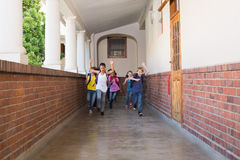 Cute pupils running down the hall Royalty Free Stock Image