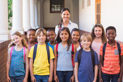 Cute pupils smiling at camera in the hall Royalty Free Stock Photo