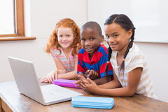 Cute pupils using computer Royalty Free Stock Photography