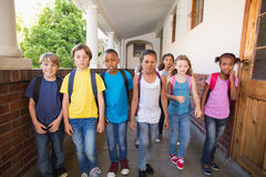 Cute pupils walking down the hall Stock Photos