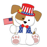 Cute Puppy Fourth of July. An adorable puppy wearing a top hat and holding the American flag. He is all ready for the Fourth of July Royalty Free Stock Photography