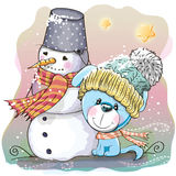 Cute Puppy and snowman Royalty Free Stock Images