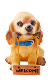 A cute puppy who will tell you Welcome. A dog made ​​of ceramic that tells you welcome royalty free stock photography