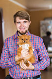 Cute purebred  chihuahua and young man Stock Images