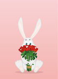 Cute rabbit with a bouquet of red roses. A hare with flowers. Royalty Free Stock Images