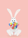 Cute rabbit with a bunch of Easter eggs. A hare with flowers. An invitation to a holiday. Vector. Free space for text Royalty Free Stock Photography