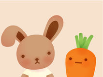 Cute Rabbit and Carrot Stock Photo