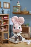 Cute rabbit doll. A pink kawaii rabbit felt doll sitting in pink living room with vintage setting. Toy photography royalty free stock photo