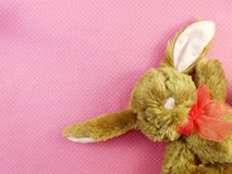 Cute rabbit doll on pink polka dot background Stock Images