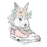 Cute rabbit in a flower wreath. Hare sitting in sneakers. Vector illustration for greeting card, poster, or print on clothes.  Royalty Free Stock Photography