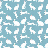 Cute rabbit illustration, seamless pattern on blue background Royalty Free Stock Photography