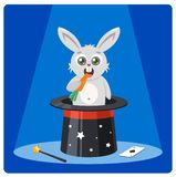 Cute rabbit in a magic hat gnaws carrots. royalty free illustration