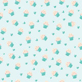 Cute rabbit in teacup and hearts illustration, seamless pattern on blue background Royalty Free Stock Images