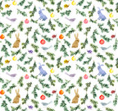 Cute rabbits, birds, christmas tree, baubles. Seamless pattern. Watercolor. Cute rabbits and birds in branches of fir tree with decorative baubles. Seamless Royalty Free Stock Photo