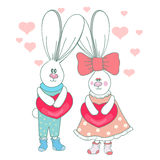 Cute rabbits with hearts. Stock Image