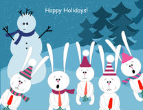 Cute rabbits and a snowman Stock Photography