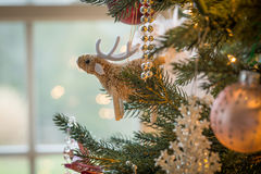 Cute raindeer on christmas tree detail Royalty Free Stock Photography