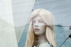 Cute realistic female blonde mannequin face close-up in a shop window. Cute realistic female mannequin face close-up in a shop window. Beautiful Caucasian Royalty Free Stock Photos