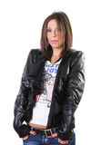 Cute rebel girl in leather jacket. Over white background Stock Photography