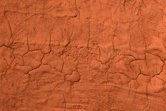 Red grunge dirty damaged painting texture - cute abstract photo background. Cute red aged weathered broken paint texture - abstract photo background stock photo