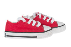 Cute red baby sneakers, isolated on white Stock Images
